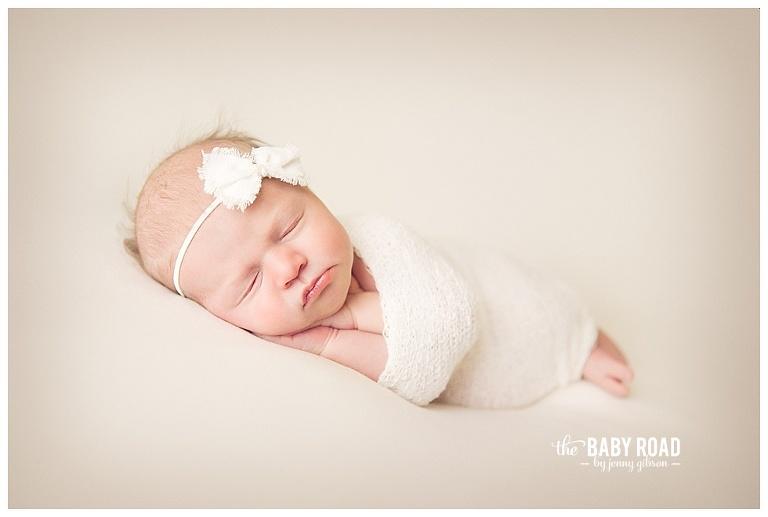 Roseburg Oregon On Location Newborn Photographer wrapped baby girl